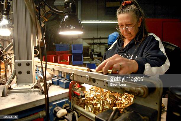 Anna Nelson puts whistles on an automatic assembly line for soldering at the American Whistle Corp in Coshocton Columbus Ohio US on Monday Jan 26...