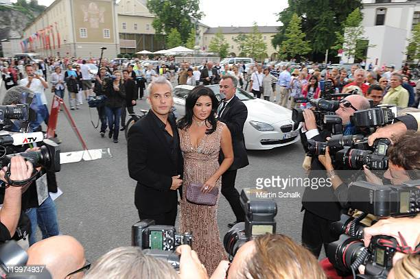 Anna Netrebko and Erwin Schrott arrive for the 'Le nozze di Figaro premiere during the Salzburg Festival on July 27 2011 in Salzburg Austria