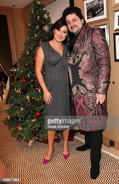 Anna Netrebko and her fiance Yusif Eyvazo pose during the Chopard Boutique reopening on November 28 2014 in Munich Germany