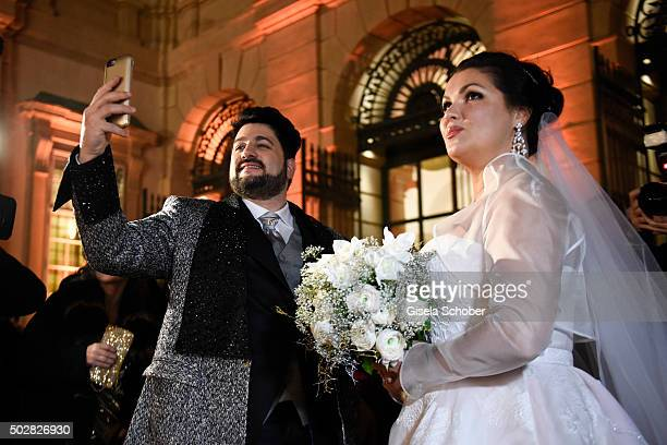 Anna Netrebko and Yusif Eyvazov watch fireworks during their wedding at Palais Liechtenstein on December 29 2015 in Vienna Austria
