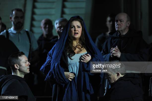 Anna Netrebko as Donna Leonora with artists of the company in The Royal Opera's production of Giuseppe Verdi's La forza del destino directed by...