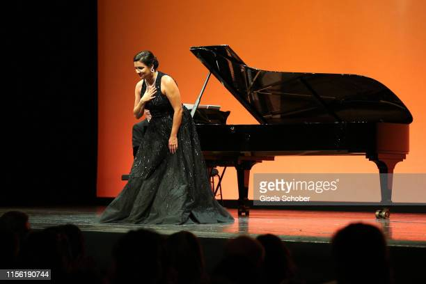 Anna Netrebko performs at the Anna Netrebko recital and charity dinner during the Munich Opera Festival 2019 at Nationaltheater on July 17 2019 in...