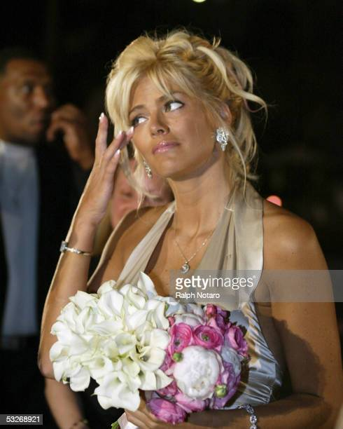 Anna Nicole Smith cries tears of joy as the Maid of Honor for Penny and Joseph Genovese as they renew their wedding vows poolside at the Seminole...