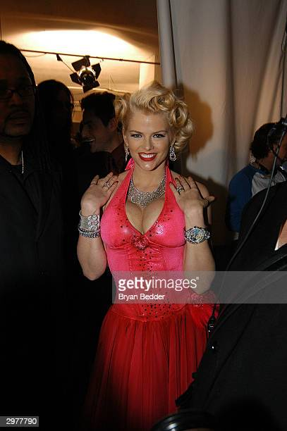 Anna Nicole Smith poses backstage at the Heatherette fashion show during Olympus Fashion Week at Bryant Park February 12 2004 in New York City
