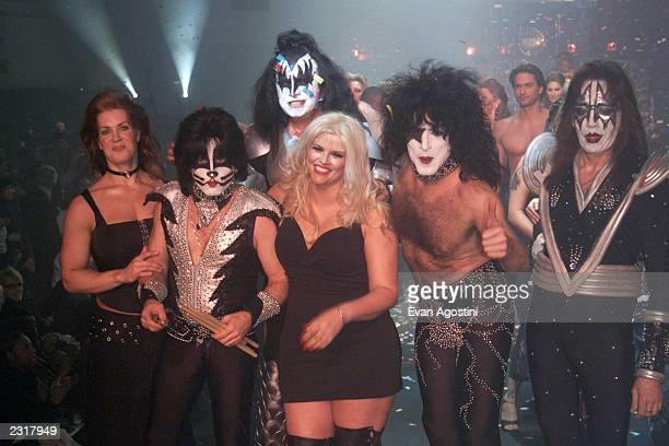 Anna Nicole Smith poses with the band Kiss and Joanie Laurer on the runway at the 'The Big Kiss' Lane Bryant's '02 Lingerie Fashion Show at Roseland...