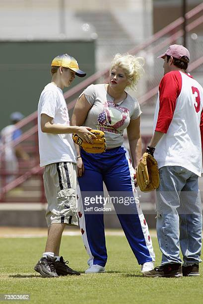 Anna Nicole Smith son Daniel Wayne Smith and Howard K Stern participate in a charity softball game on June 30 2002 at Dedeaux Field in Los Angeles...
