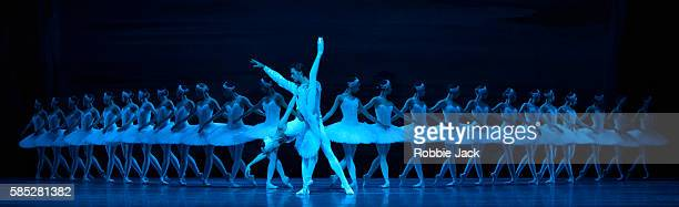 Anna Nikulina as Odette/Odile and Ruslan Skvortsov as Prince Siegfried with artists of the company in the Bolshoi Ballet's production of Swan Lake...