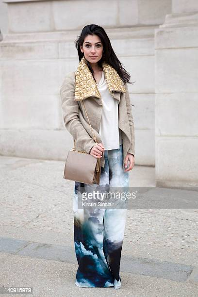 Anna Nooshin executive editor of nsmbl wearing Marlous Blaas trousers Dennis thm jacket brooms bazaar top vintage bag Michael Kors shoes at Paris...