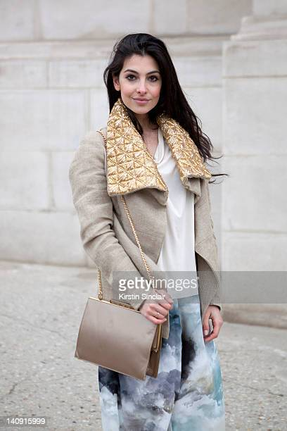 Anna Nooshin executive editor of nsmbl wearing Marlous Blaas trousers Dennis thm jacket brooms bazaar top vintage bag at Paris Fashion Week...