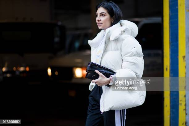 Anna Nooshin wearing white puffer jacket seen outside Zadig Voltaire on February 12 2018 in New York City
