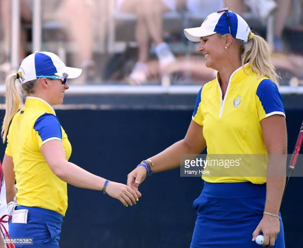 Anna Nordqvist and Jodi Ewart Shadoff of Team Europe celebrate a four and two win over Team USA during the evening fourball matches of the Solheim...
