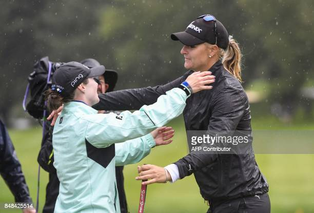 Anna Nordqvist from Sweden is congratulated byBrittany Altomare from United States after winning the Evian Championship tournament on September 17...