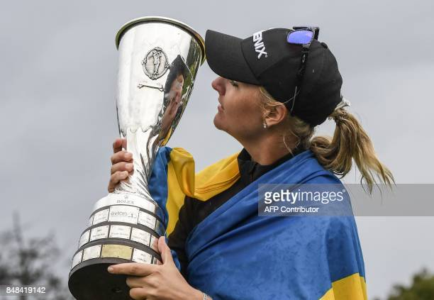 Anna Nordqvist from Sweden kisses her trophy after winning the Evian Championship tournament on September 17 2017 in the French Alps town of...