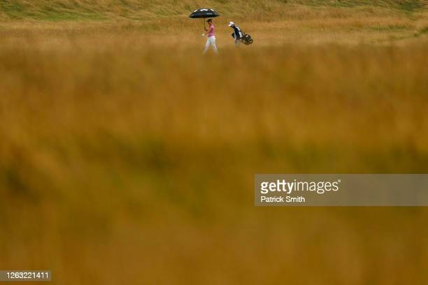 Anna Nordqvist of Sweden and her caddie walk along the seventh hole during the second round of the LPGA Drive On Championship at Inverness Club on...