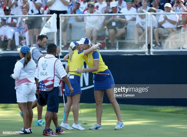Anna Nordqvist of Sweden and the European Team embraces her partner Jodi Ewart Shadoff of England after they had won their match against Lizette...
