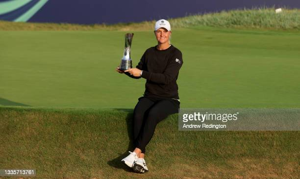 Anna Nordqvist of Sweden celebrates with the winners trophy on the 18th green after the final round of the AIG Women's Open at Carnoustie Golf Links...