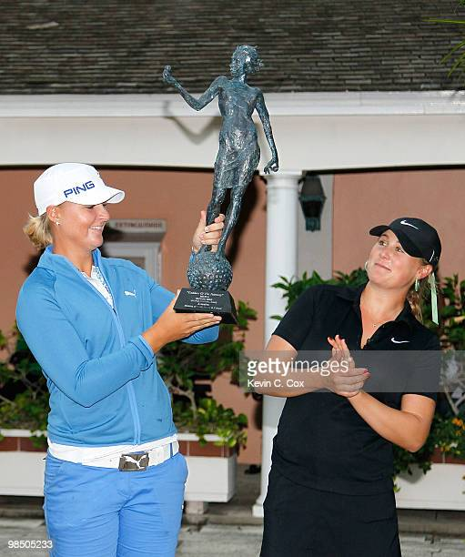 Anna Nordqvist of Sweden lifts up the 'Goddess the Fairway' trophy after defeating Amanda Blumenherst of the United States in the final match of The...