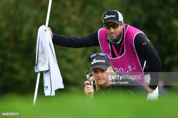 Anna Nordqvist of Sweden lines up a putt with her caddie during the final round of The Evian Championship at Evian Resort Golf Club on September 17...