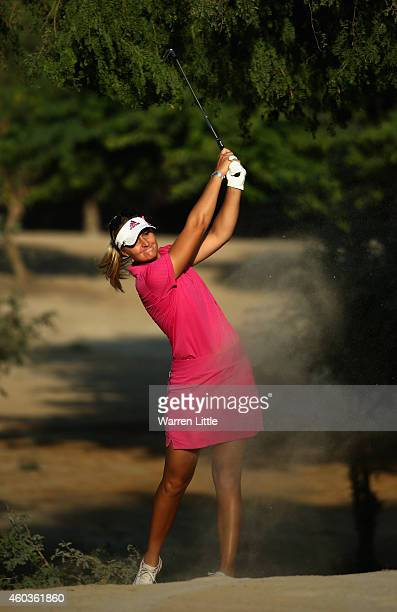 Anna Nordqvist of Sweden plays her second shot into the 14th green during the third round of the Omega Dubai Ladies Masters on the Majlis Course at...