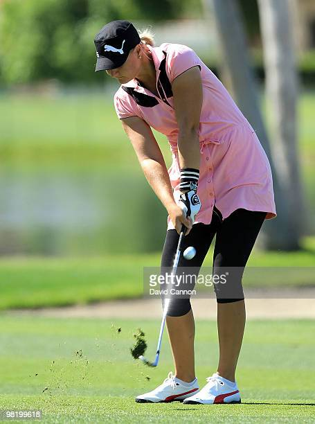 Anna Nordqvist of Sweden plays her third shot at the 18th hole during the first round of the 2010 Kraft Nabisco Championship on the Dinah Shore...