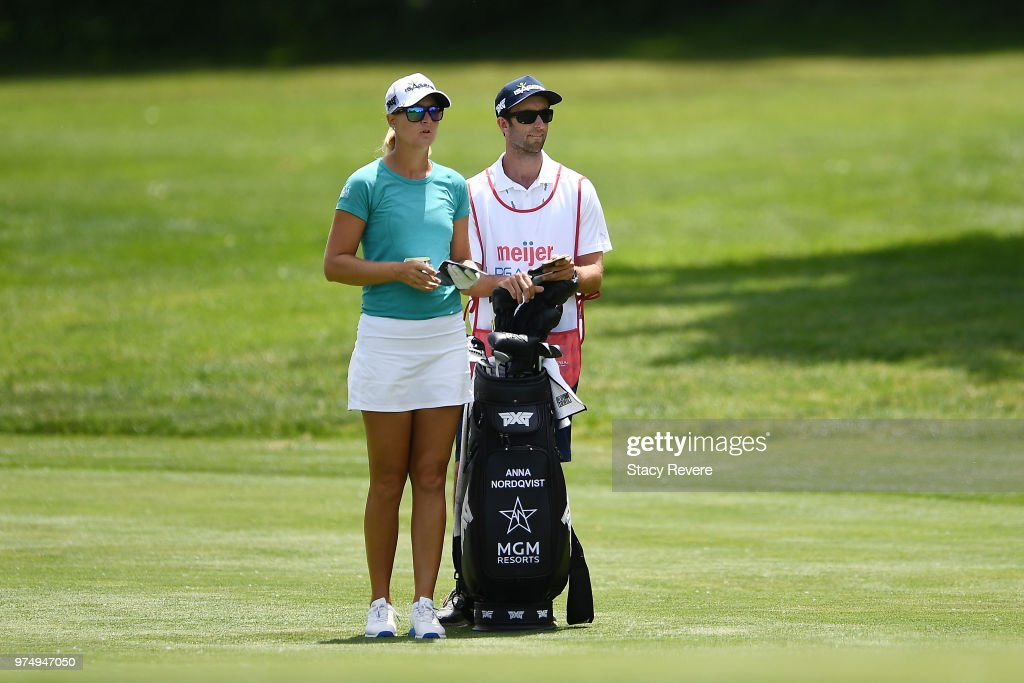 Anna Nordqvist of Sweden speaks with her caddie on the first hole during the first round of the Meijer LPGA Classic for Simply Give at Blythefield Country Club on June 14, 2018 in Grand Rapids, Michigan.