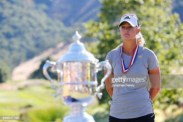Anna Nordqvist of Sweden watches the awards ceremony on the 18th green after losing a three hole playoff against Brittany Lang after the final round...