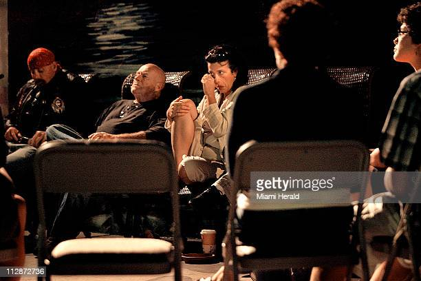Anna O'Connell wipes her eyes as she and others participate in a counseling session for recovering addicts held at KoffeeOkee coffeehouse in Delray...