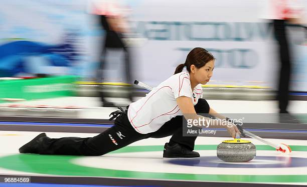Anna Ohmiya of Japan releases a stone during the Women's Curling Round Robin match between Great Britain and Japan on day 8 of the Vancouver 2010...