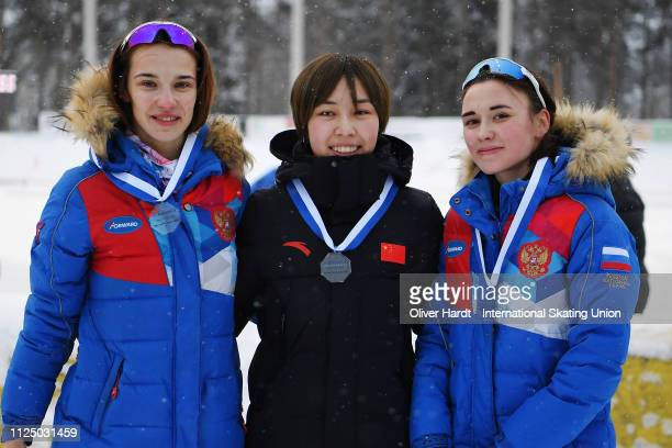 Anna Opytova of Russia with the silver medal Adake Ahena Er of China with the gold medal and Veronika Suslova of Russia with the bronze medal...
