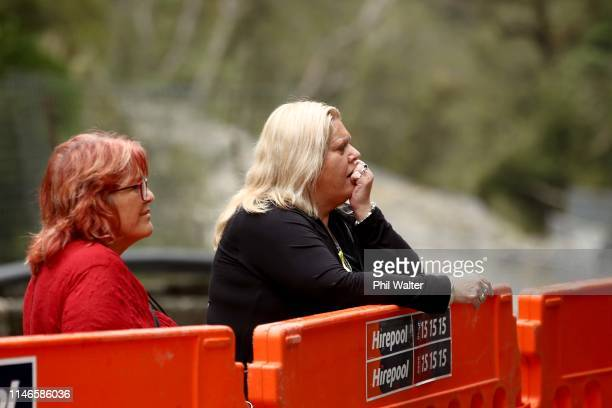 Anna Osborne and Sonya Rockhouse from the Family Reference Group pause for reflection at the entrance to the Pike River Coal mine on May 03, 2019 in...