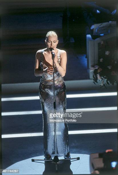 Anna Oxa performing a song on the stage of the Teatro Ariston during the XLIV edition of the Sanremo Music Festival in addition to these occasional...
