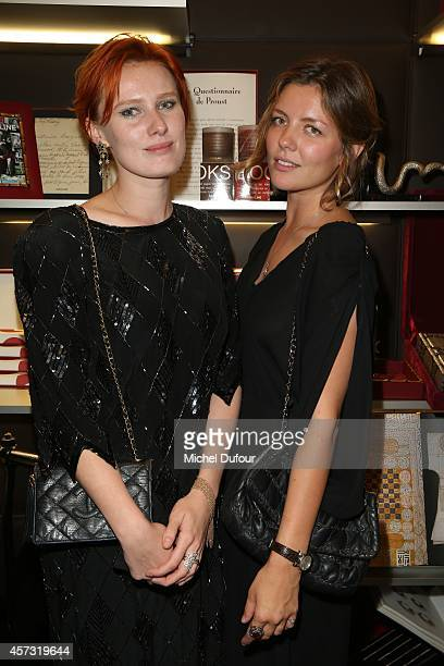 Anna Pahlavi and Vera Mischina attend the 'Gypset Living' cocktail At Boutique Assouline on October 16 2014 in Paris France