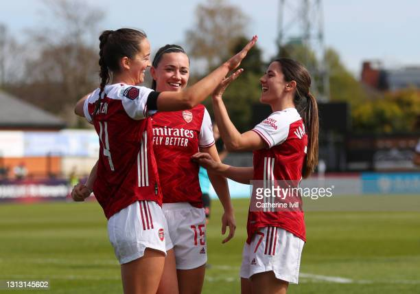 Anna Patten of Arsenal celebrates after she scores her sides seventh goal with Katie McCabe and Danielle Van de Donk of Arsenal during the Vitality...