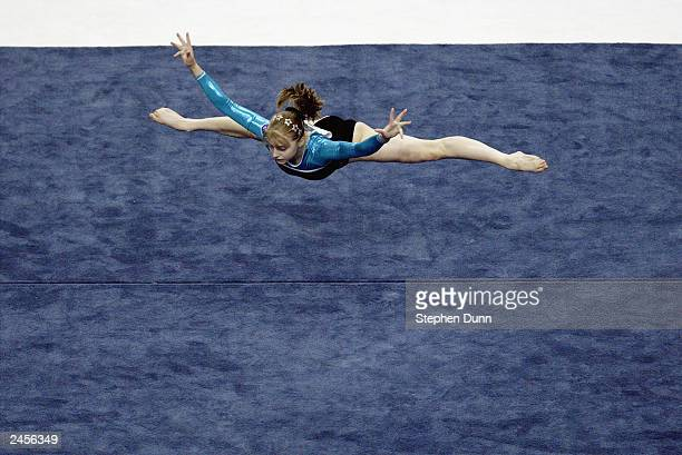 Anna Pavlova of Russia competes in the women's floor exercise during the Apparatus Finals of the 2003 World Gymnastics Championships at the Arrowhead...