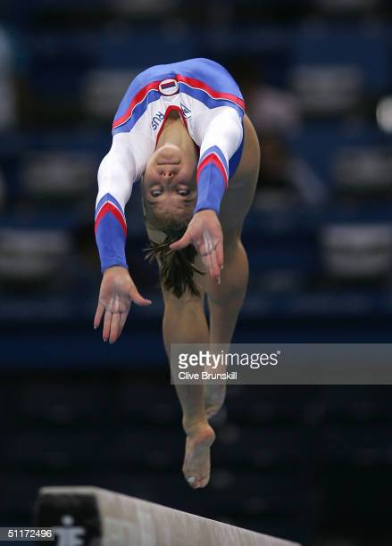 Anna Pavlova of Russia competes on the balance beam in the qualification round of the team event at the women's artistic gymnastics competition on...