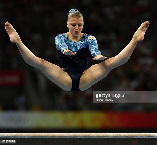 Anna Pavlova of Russia competes on the uneven bars during the women's individual allaround artistic gymnastics final at the National Indoor Stadium...