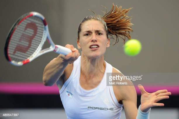 Anna Petkovic of Germany plays a forehand shot against Samantha Stosur of Australia during the Fed Cup Semi Final tie between Australia and Germany...