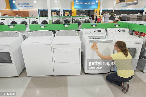 Anna Phillips prepares merchandise on the sales floor at an hhgregg store on August 22 2011 in Niles Illinois The store is 1 of 14 stores the...