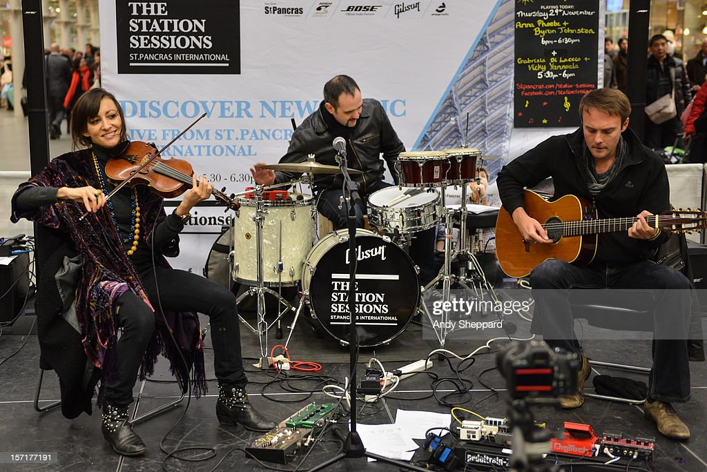 Anna Phoebe (L) and Byron Johnston (R) perform as part of the Station Sessions 2012 at St Pancras Station on November 29, 2012 in London, England.
