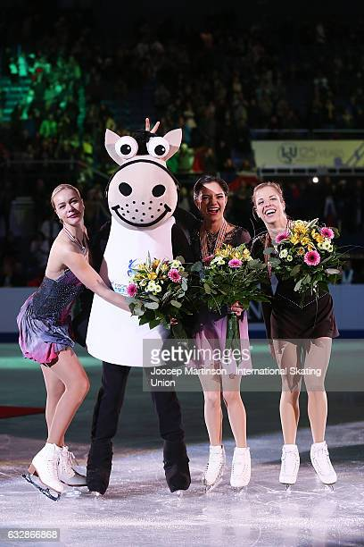 Anna Pogorilaya and Evgenia Medvedeva of Russia and Carolina Kostner of Italy pose in the Ladies medal ceremony during day 3 of the European Figure...