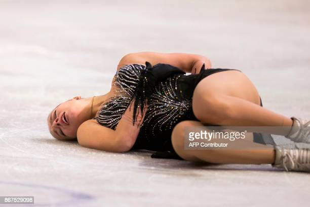 Anna Pogorilaya of Russia lies on the ice after a hard fall during her free program at the 2017 Skate Canada International ISU Grand Prix event in...