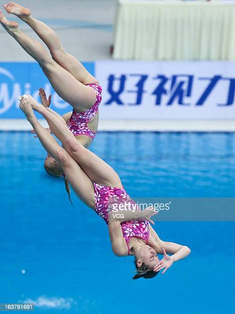 Anna Pysmenska and Olena Fedorova of Ukraine compete in the Women's 3m Springboard Synchro Final during day one of the FINA Diving World Series...