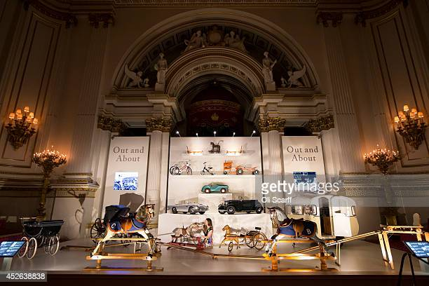 Anna Reynolds curator of Royal Collection Trust puts the finishing touches to a display of prams rocking horses toy cars used by members of the Royal...