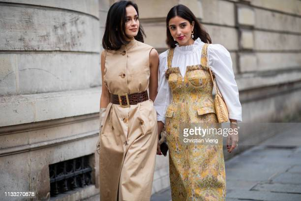 Anna Rosa Vitello is seen wearing beige sleeveless dress gloves and Bettina Looney wearing golden dress white blouse outside Elie Saab during Paris...