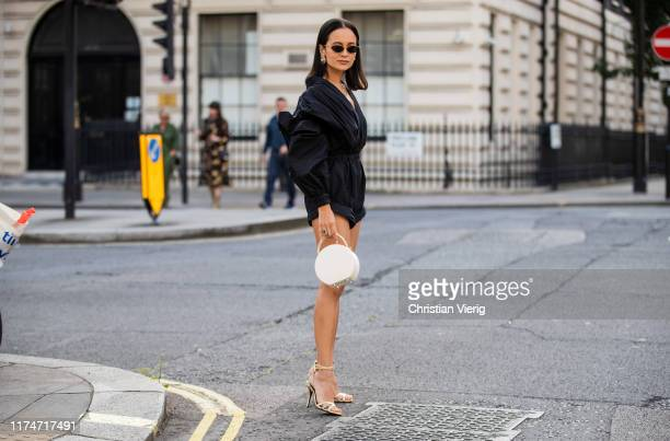 Anna Rosa Vitiello is seen wearing black overall, white bag, heels outside Toga during London Fashion Week September 2019 on September 14, 2019 in...