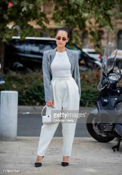 Anna Rosa Vitiello is seen wearing grey blazer, white high waist pants, white mini bag, top outside the Sportmax show during Milan Fashion Week...