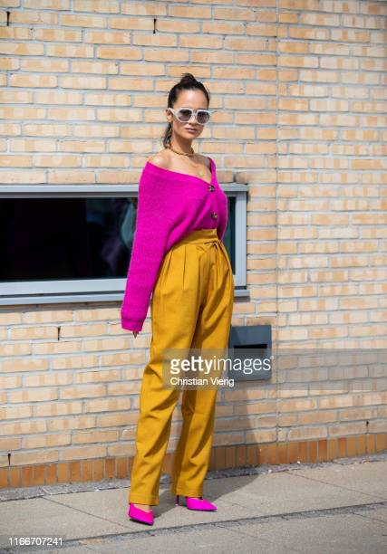 Anna Rosa Vitiello is seen wearing pink cardigan, mustard pants outside Holzweiler during Copenhagen Fashion Week Spring/Summer 2020 on August 07,...