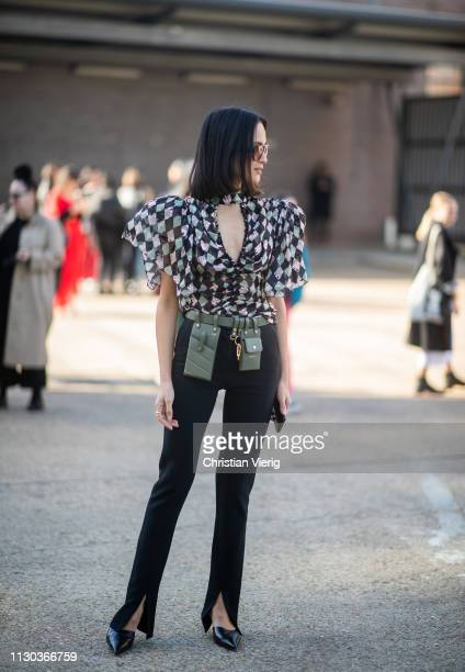 Anna Rosa Vitiello is seen wearing plaid sheer blouse, green belt with bags outside Preen during London Fashion Week February 2019 on February 17,...