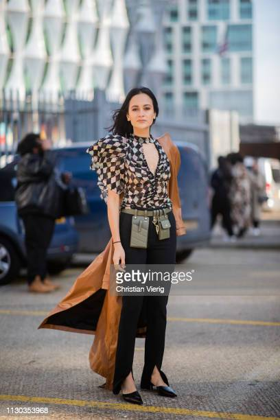 Anna Rosa Vitiello is seen wearing ruffled top belt with bags pants with slit outside Preen during London Fashion Week February 2019 on February 17...