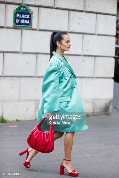 Anna Rosa Vitiello is seen wearing turquoise coat, red coat outside Miu Miu during Paris Fashion Week - Womenswear Fall/Winter 2020/2021 : Day Nine...